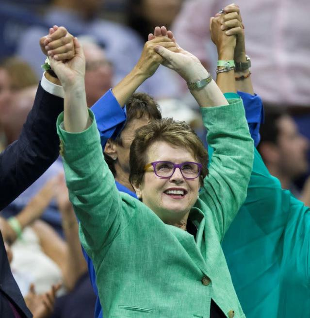 FILE PHOTO: Tennis great Billie Jean King holds hands with other attendees as Serena Williams of the U.S. faces her sister and compatriot Venus Williams in their quarterfinals match at the U.S. Open Championships tennis tournament in New York