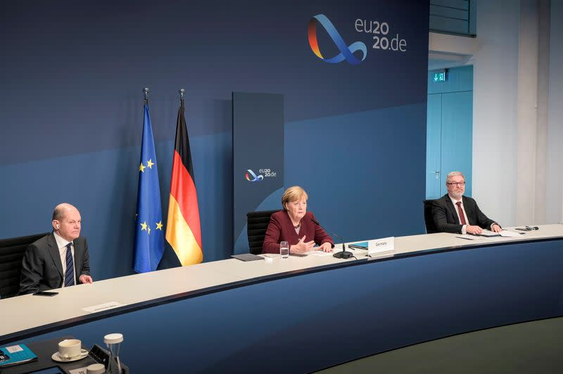 German Chancellor Merkel and Finance Minister Scholz take part in a video conference during the G20 Leaders' Summit 2020