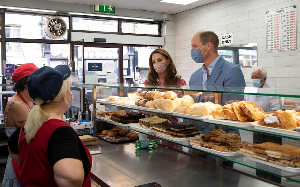 The Duke and Duchess of Cambridge during a visit to Beigel Bake Brick Lane Bakery in east London - AFP