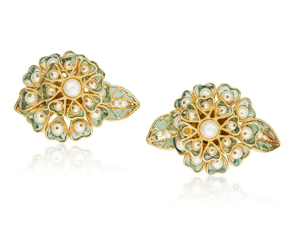 <p>Designed after one of our favorite blooms, these earrings are estimated to be worth $2,000 to $3,000.</p>