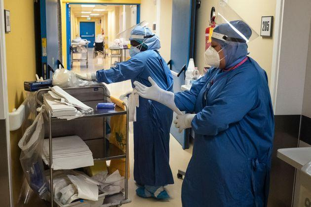 Nurses at the Covid hospital ward of the GVM Maria Pia Hospital in Turin prepare to visit patients infected with Covid-19 on April 4, 2021. (Photo by MARCO BERTORELLO / AFP) (Photo by MARCO BERTORELLO/AFP via Getty Images) (Photo: MARCO BERTORELLO via AFP via Getty Images)