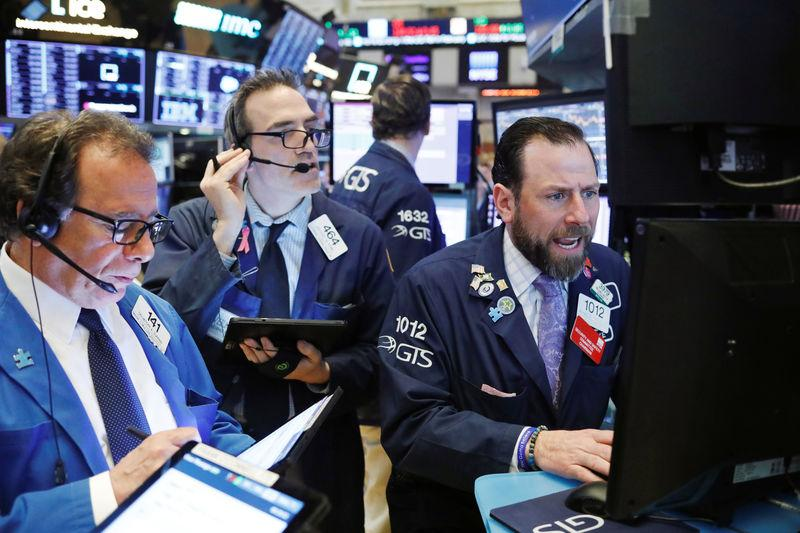 Traders work on the floor of the New York Stock Exchange (NYSE) shortly after the opening bell in New York, U.S., March 26, 2019. REUTERS/Lucas Jackson