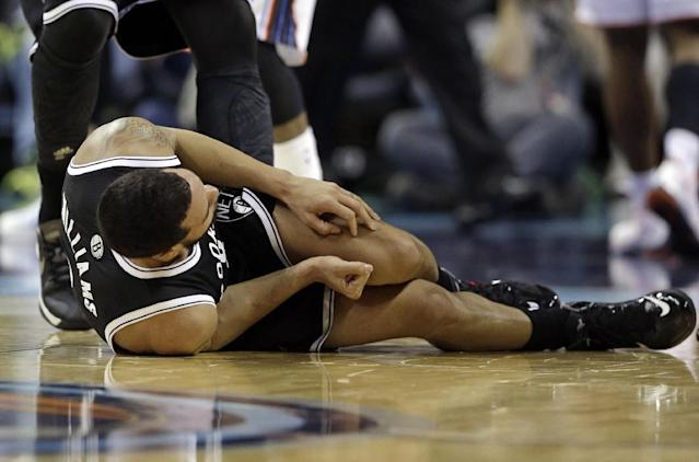 Brooklyn Nets' Deron Williams grabs his leg after being injured during the first half of an NBA basketball game against the Charlotte Bobcats in Charlotte, N.C., Wednesday, Nov. 20, 2013. The Nets announced Williams has a sprained ankle. (AP Photo/Chuck Burton)