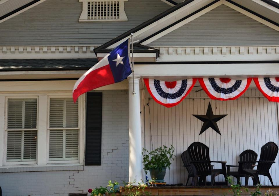 House with Texas flag on the lawn