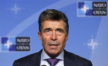 NATO Secretary General Rasmussen addresses a news conference in Brussels