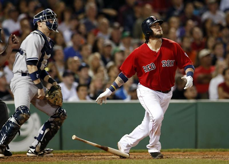Boston Red Sox's Jarrod Saltalamacchia watches his grand slam in front of New York Yankees catcher Chris Stewart during the seventh inning of a baseball game at Fenway Park in Boston on Friday, Sept. 13, 2013. (AP Photo/Elise Amendola)