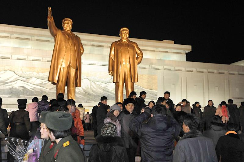 North Koreans visit giant statues of their late leaders Kim Il Sung, left, and Kim Jong Il at Mansu Hill as they celebrate the New Year in Pyongyang, North Korea, early Tuesday, Jan. 1, 2013. North Korean leader Kim Jong Un on Tuesday called for improving the economy and living standards of his impoverished nation with the same urgency that scientists showed in successfully testing a long-range rocket recently. (AP Photo/Kyodo News) JAPAN OUT, MANDATORY CREDIT, NO LICENSING IN CHINA, HONG KONG, JAPAN, SOUTH KOREA AND FRANCE