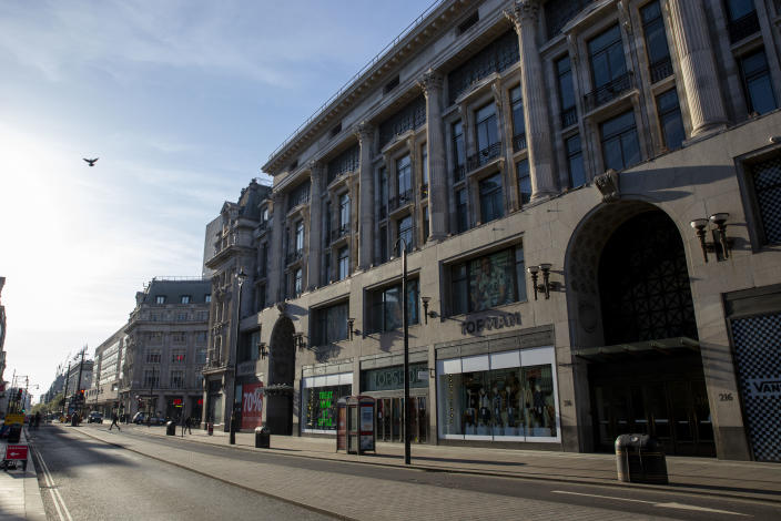 Major shops on Oxford Street, closed for business. March 24th 2020 was the first day of enforced lockdown in the UK, in order to stop the spread of the Coronavirus Covid 19. On what would normally be a bustling business / week day in London, the city was deserted, with just a few people in masks out on the street, plus a few taxis and mostly empty buses. (photo by Phil Clarke Hill/In Pictures via Getty Images)