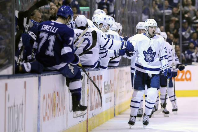 Toronto Maple Leafs center Auston Matthews (34) celebrates his second-period goal against the Tampa Bay Lightning during NHL hockey game action in Toronto, Monday, March 11, 2019. (Cole Burston/The Canadian Press via AP)