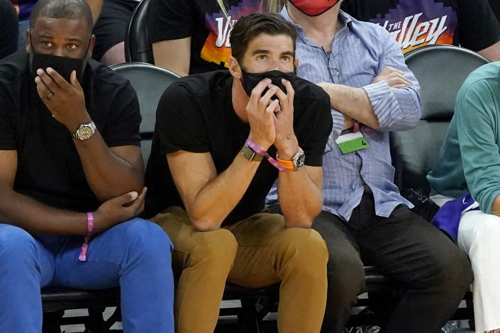 Former olympic swimmer Michael Phelps watches the Phoenix Suns and the Denver Nuggets 118during the first half of Game 2 of an NBA basketball second-round playoff series, Wednesday, June 9, 2021, in Phoenix. (AP Photo/Matt York)