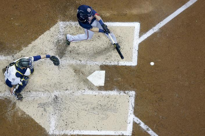 Atlanta Braves' Austin Riley hits a two-run scoring single during the third inning of a baseball game against the Milwaukee Brewers Friday, May 14, 2021, in Milwaukee. (AP Photo/Morry Gash)