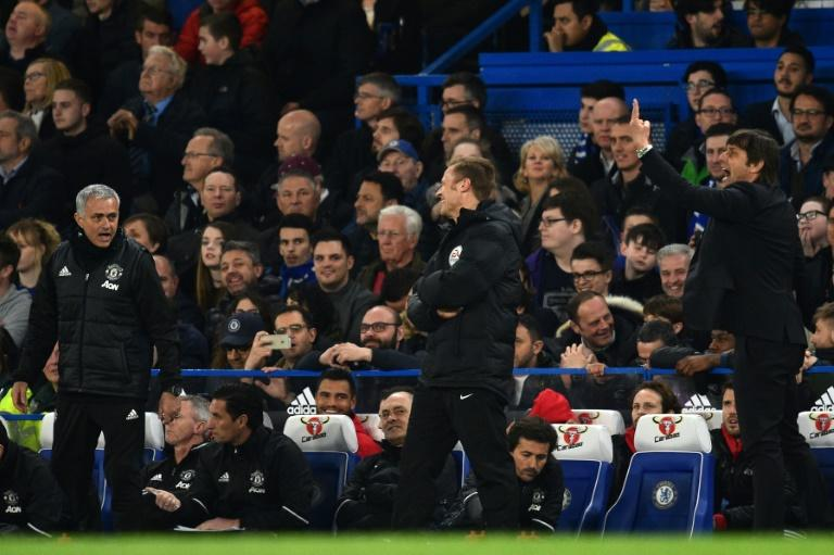 Fourth official Mike Jones (C) laughs as Manchester United's manager Jose Mourinho (L) yells at Chelsea's head coach Antonio Conte during their English FA Cup quarter-final match, at Stamford Bridge in London, on March 13, 2017