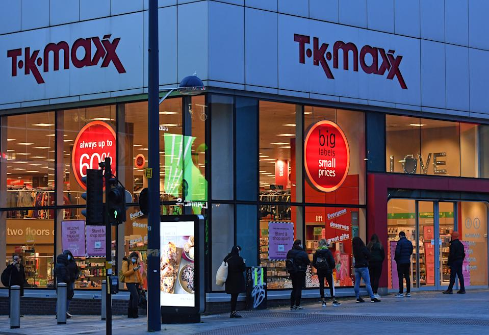 People queueing outside T.K.Maxx in Birmingham on the first day shops re-open after the second national lockdown ends and England has a strengthened tiered system of regional coronavirus restrictions.