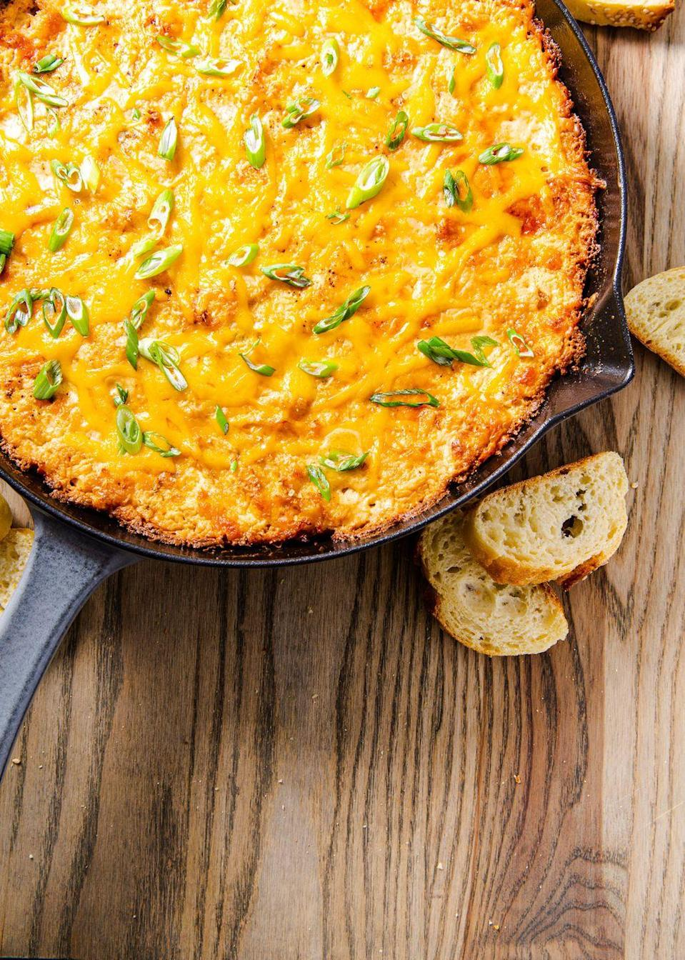 """<p>Cheese pulls for daysssss.</p><p>Get the recipe from <a href=""""https://www.delish.com/cooking/recipe-ideas/a30195933/easy-hot-crab-dip-recipe/"""" rel=""""nofollow noopener"""" target=""""_blank"""" data-ylk=""""slk:Delish"""" class=""""link rapid-noclick-resp"""">Delish</a>.</p>"""