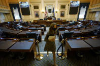House speaker Del. Eileen Filler-Corn, D-Fairfax, exits the center isle of the empty VirginianHouse of Delegates chamber after a Zoom Legislative session at the Capitol in Richmond, Va., Wednesday, Feb. 10, 2021. (AP Photo/Steve Helber)