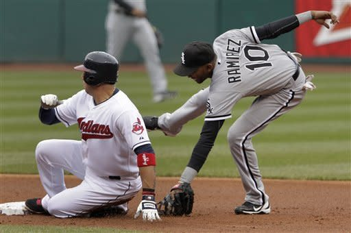 Cleveland Indians' Asdrubal Cabrera slides safely into second, beating the tag by Chicago White Sox shortstop Alexei Ramirez (10) in the first inning of a baseball game in Cleveland on Wednesday, April 11, 2012. (AP Photo/Amy Sancetta)