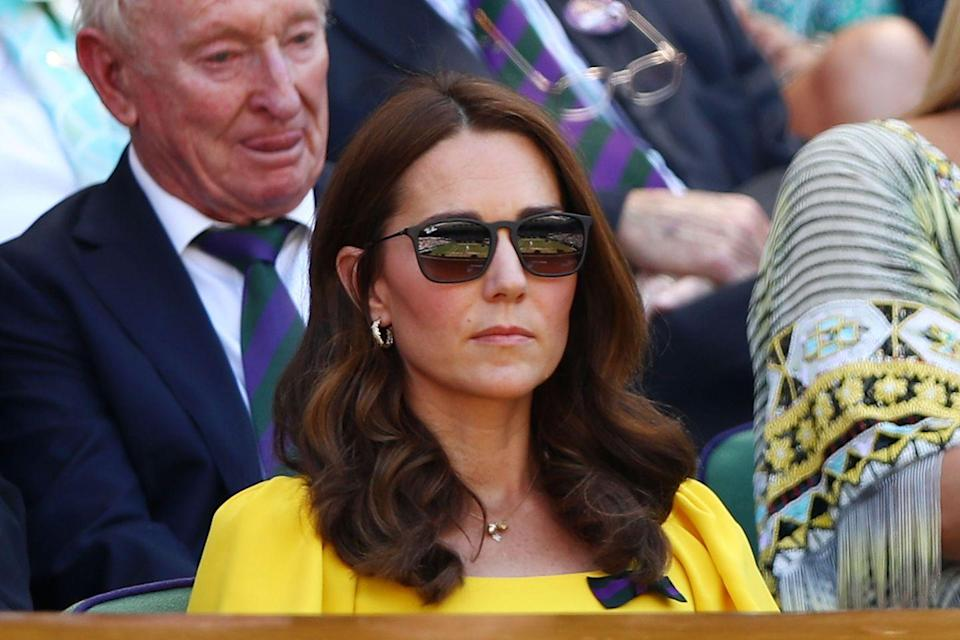<p>Kate wore a gold charm necklace and gold hoops to Wimbledon in July 2018. </p>