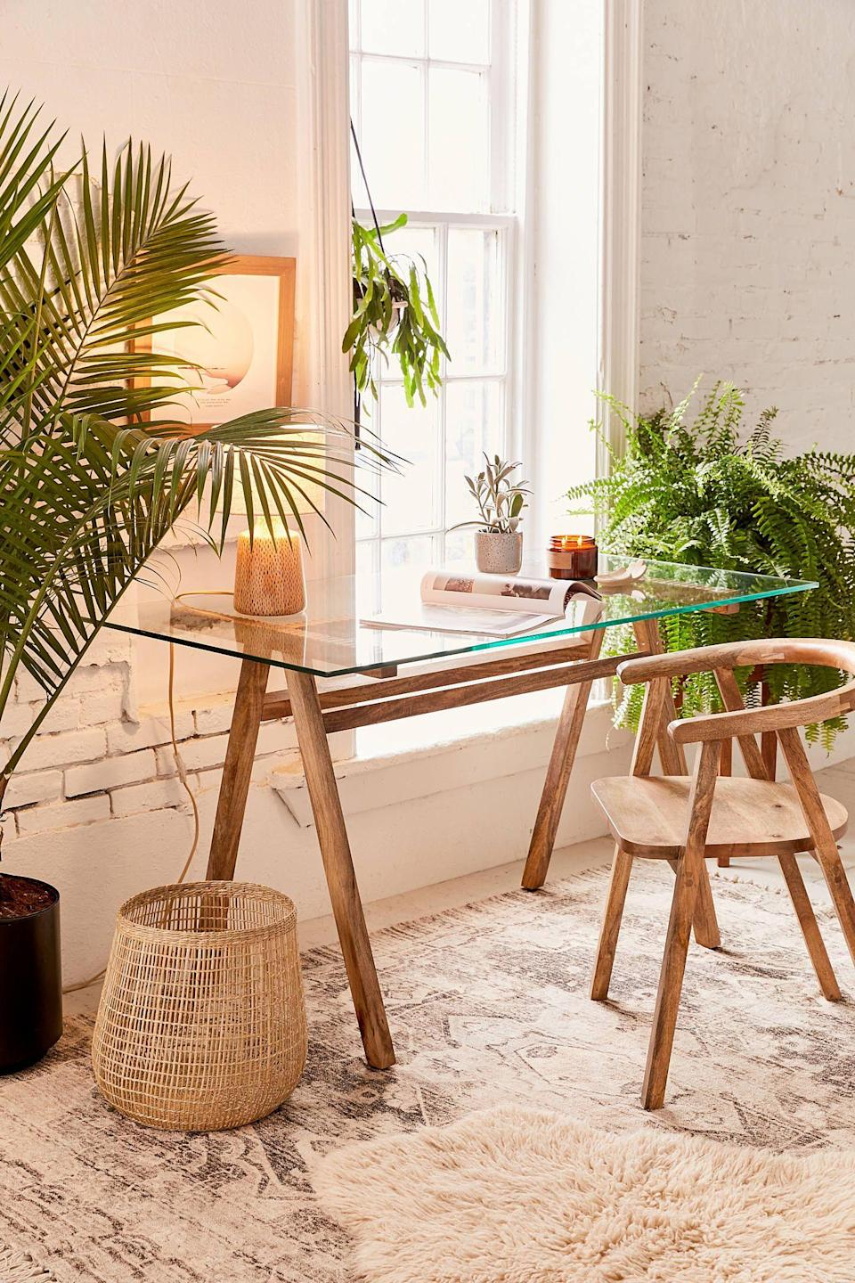 """<p><strong>Urban Outfitters</strong></p><p>urbanoutfitters.com</p><p><strong>$349.00</strong></p><p><a href=""""https://go.redirectingat.com?id=74968X1596630&url=https%3A%2F%2Fwww.urbanoutfitters.com%2Fshop%2Fashford-desk&sref=https%3A%2F%2Fwww.countryliving.com%2Fhome-design%2Fdecorating-ideas%2Fg29307726%2Fdesks-for-small-spaces%2F"""" rel=""""nofollow noopener"""" target=""""_blank"""" data-ylk=""""slk:Shop Now"""" class=""""link rapid-noclick-resp"""">Shop Now</a></p><p>The glass top isn't visually heavy, which ensures your place will not feel cluttered. </p>"""