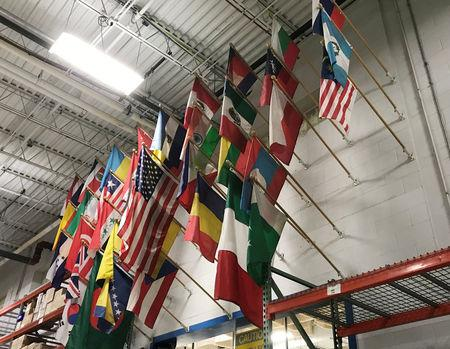 Flags representing the countries of origin of the 900 employees at HydraForce Inc., hang above the factory floor at the firm's plant in Lincolnshire, Illinois, U.S., January 10, 2018. Photo taken January 10 2018.    REUTERS/Ann Saphir