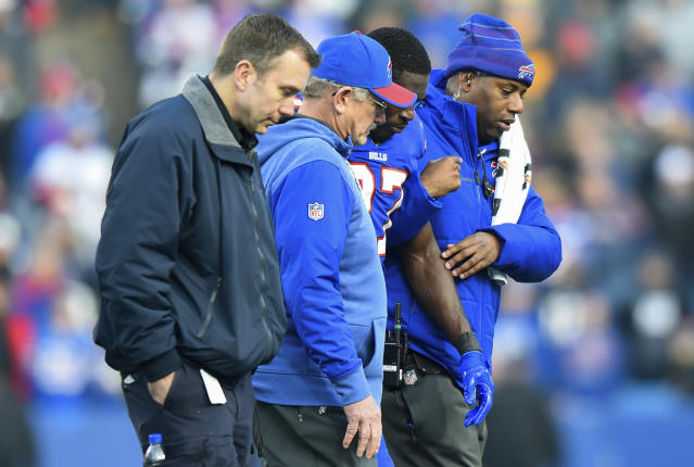 FILE - In this Sunday, Dec. 3, 2017, file photo, Buffalo Bills trainers assists cornerback Tre'Davious White (27) off the field after being injured on a late hit by New England Patriots tight end Rob Gronkowski during the second half of an NFL football game, Sunday, Dec. 3, 2017, in Orchard Park, N.Y. (AP Photo/Rich Barnes, File)