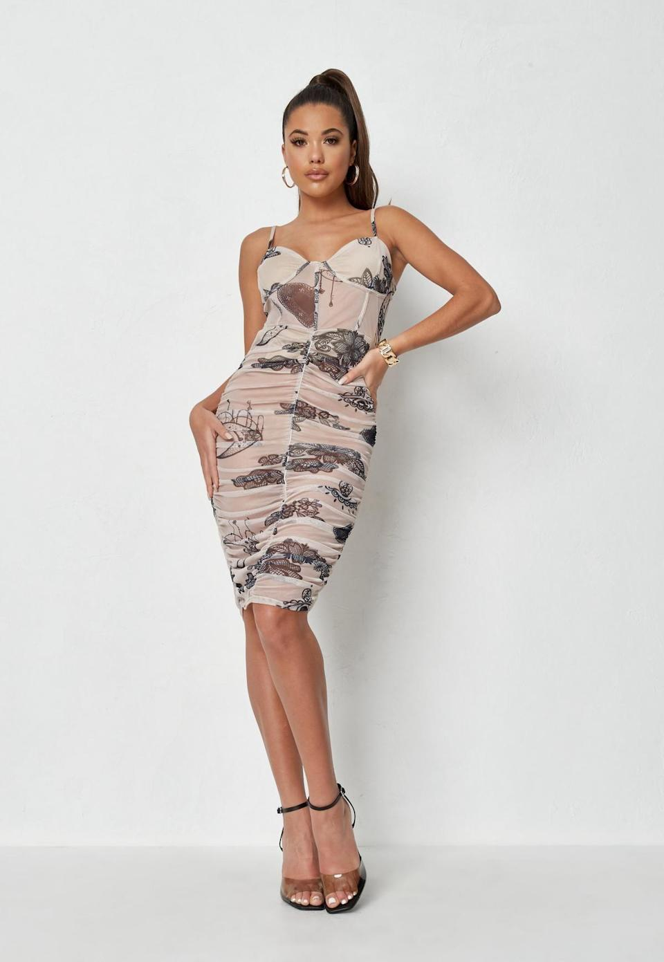 <p>Dear minimalists, we're not saying you *have* to embrace colorful prints – Nail the look just as well in this <span>Missguided Sand Butterfly Mesh Corset Midi Dress</span> ($31, originally $62).</p>