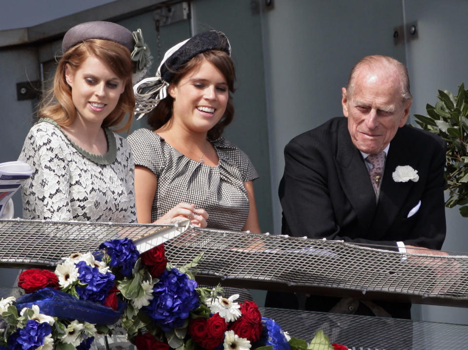 <p>Prince Phillip spent some quality time with grandaughter's Princess Beatrice and Princess Eugenie at Derby Day at the Investec Derby Festival in 2012 Photo: Getty Images.</p>