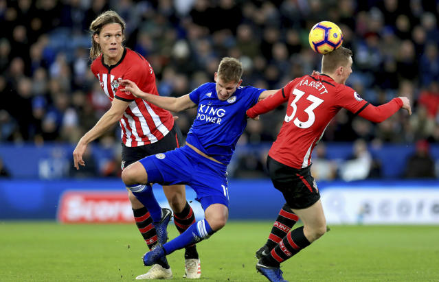 Leicester City's Marc Albrighton, center, battles for the ball with Southampton's Matt Targett, right, and Jannik Vestergaard during the English Premier League soccer match between Leicester City and Southampton at the King Power stadium, Leicester, England. Saturday, Jan. 12, 2019 (Mike Egerton/PA via AP)