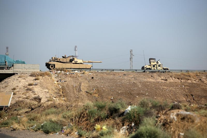 Iraqi army vehicles pictured on a road in the town of Samarra, in the northern province of Tikrit, on July 12, 2014