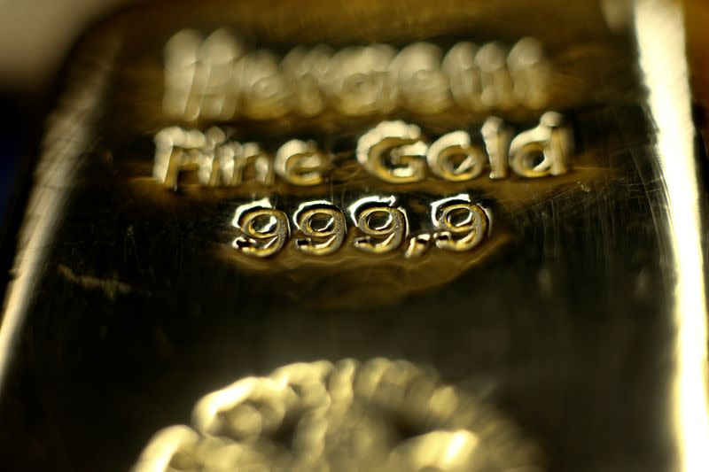 Gold slips as investors look to dollar for safety from virus woes