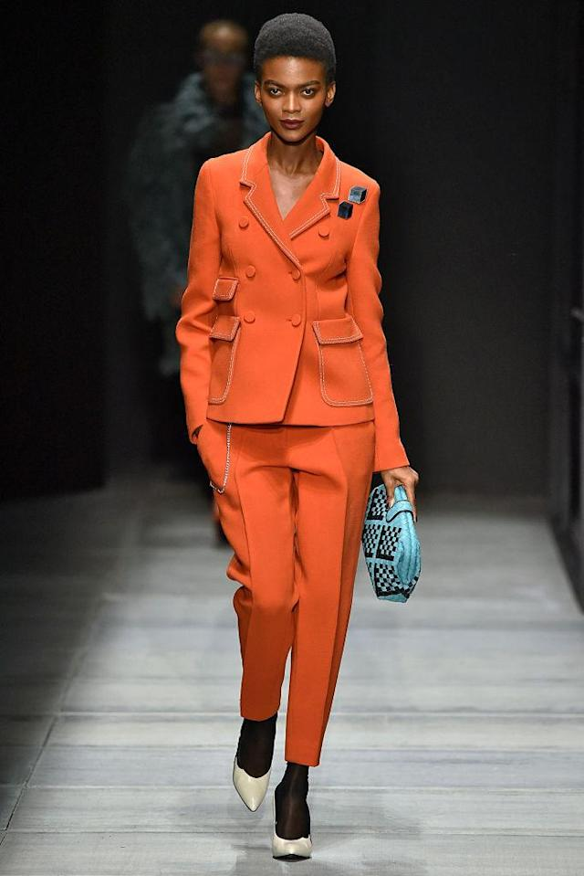<p>Model wears an orange double-breasted pantsuit at the fall 2018 Bottega Veneta show. (Photo: Getty Images) </p>