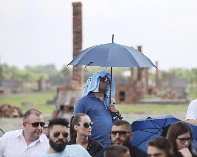 People gather to commemorate the Roma and Sinti people killed by Nazi Germany in World War II, during ceremonies at Oswiecim, Poland, Friday Aug. 2, 2019. The American civil rights activist Rev. Jesse Jackson gathered Friday with survivors at the former Nazi death camp of Auschwitz-Birkenau to commemorate an often forgotten genocide — that of the Roma people. (AP Photo/Czarek Sokolowski)
