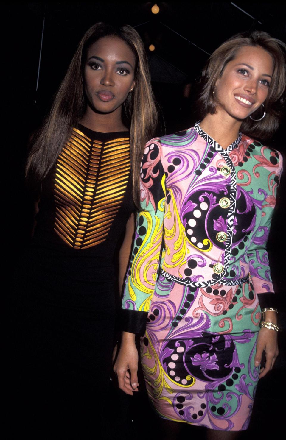 <p>Naomi and Christy are spotted in colourful attire for a wedding, 1991</p>