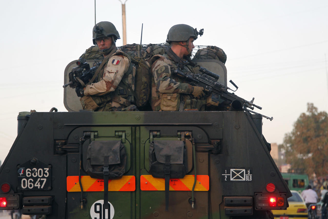 French troops in two armored personnel carriers drive through Mali's capital Bamako on the road to Mopti Tuesday Jan. 15, 2013. French forces led an all-night aerial bombing campaign Tuesday to wrest control of a small Malian town from armed Islamist extremists who seized the area, including its strategic military camp. A a convoy of 40 to 50 trucks carrying French troops crossed into Mali from Ivory Coast as France prepares for a possible land assault. Several thousand soldiers from the nations neighboring Mali are also expected to begin arriving in coming days. (AP Photo/Jerome Delay)