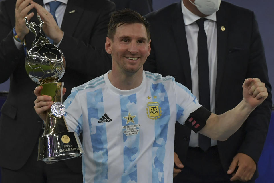 Argentina's Lionel Messi holds the trophy for the championship's Top Scorer after winning the Conmebol 2021 Copa America football tournament final match against Brazil at Maracana Stadium in Rio de Janeiro, Brazil, on July 10, 2021. (Photo by NELSON ALMEIDA / AFP) (Photo by NELSON ALMEIDA/AFP via Getty Images)