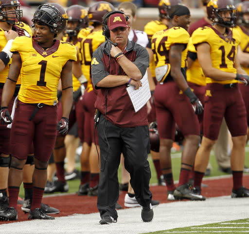 Minnesota head coach Jerry Kill walks the sidelines during the first quarter of an NCAA college football game against Western Illinois in Minneapolis, Saturday, Sept. 14, 2013. (AP Photo/Ann Heisenfelt)