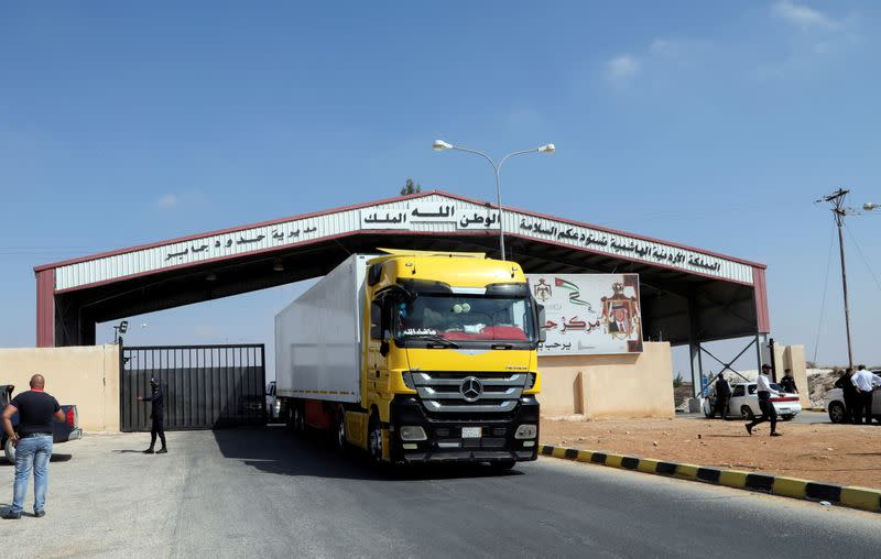 FILE PHOTO: A truck drives through the major Jaber border crossing with Syria, near Mafraq