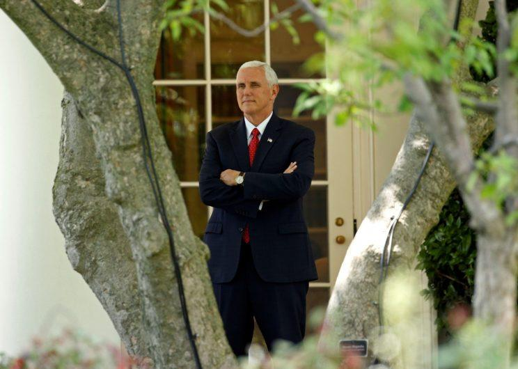 U.S. Vice President Mike Pence watches as U.S. President Donald Trump departs the White House to embark on his trip to the Middle East and Europe, in Washington, U.S., May 19, 2017.