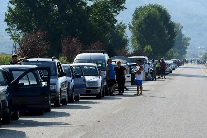 Thousands of Albanians queued in their cars at the Greek border, hoping to squeeze across and return to work before tougher entry requirements come into effect