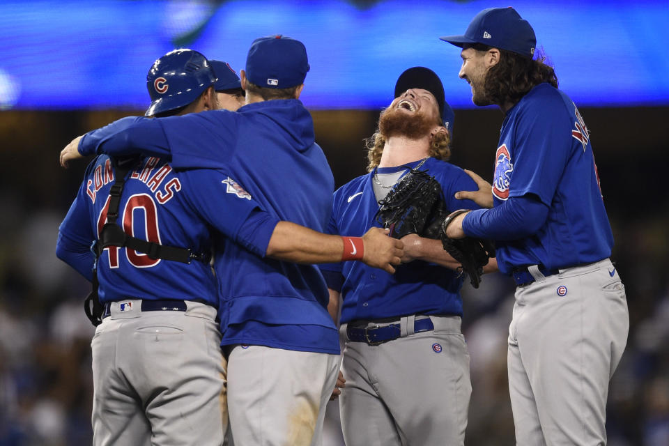 The Chicago Cubs celebrate a combined no-hitter after the final out by relief pitcher Craig Kimbrel, second from right, after a baseball game against the Los Angeles Dodgers in Los Angeles, Thursday, June 24, 2021. The Cubs won 4-0. (AP Photo/Kelvin Kuo)