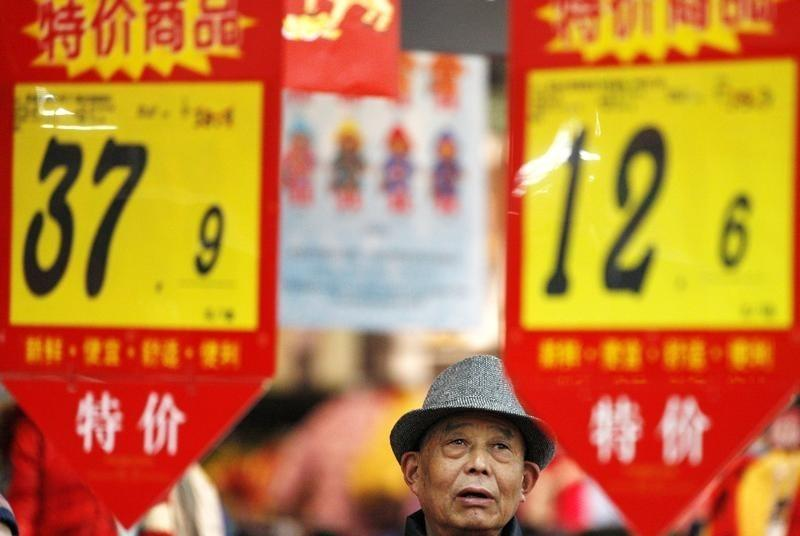 A customer looks at price tags at a supermarket in Huaibei
