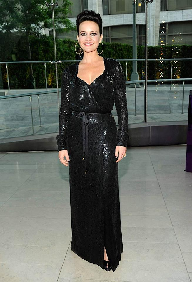 "Actress Carla Gugino, who will star alongside Jim Carrey in the upcoming film, ""Mr. Popper's Penguins,"" sparkled in a belted black number. Kevin Mazur/<a href=""http://www.wireimage.com"" target=""new"">WireImage.com</a> - June 6, 2011"