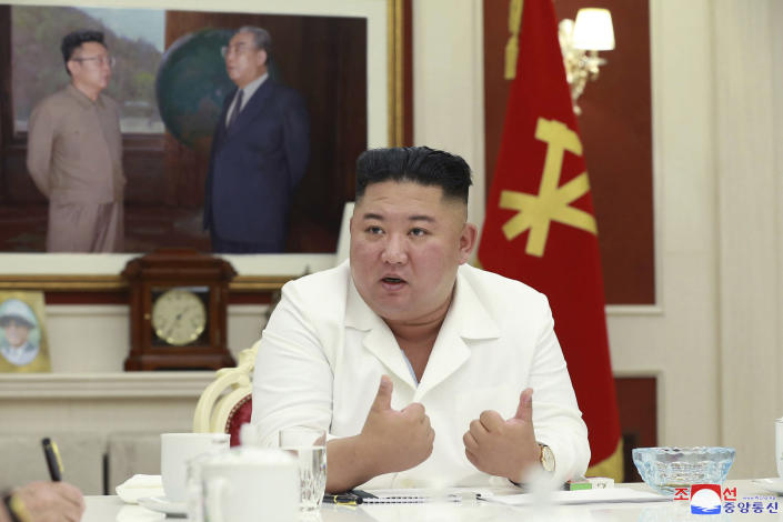 """In this photo provided by the North Korean government, North Korean leader Kim Jong Un, presides over an executive policy council meeting at the ruling Workers' Party in Pyongyang, North Korea, Wednesday, Aug. 5, 2020. Kim Jong Un directed his government agencies to act immediately to stabilize the livelihoods of residents in a city locked down over coronavirus concerns, state media reported Thursday, Aug. 6, 2020. Independent journalists were not given access to cover the event depicted in this image distributed by the North Korean government. The content of this image is as provided and cannot be independently verified. Korean language watermark on image as provided by source reads: """"KCNA"""" which is the abbreviation for Korean Central News Agency. (Korean Central News Agency/Korea News Service via AP)"""