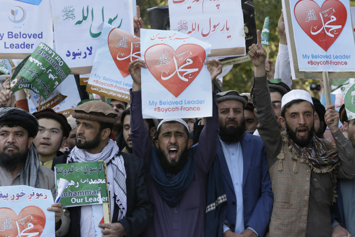 Afghans shout slogans during a protest against French President Macron's comments over Prophet Muhammad caricatures, in Kabul, Afghanistan, Friday, Oct. 30, 2020. (AP Photo/Mariam Zuhaib)