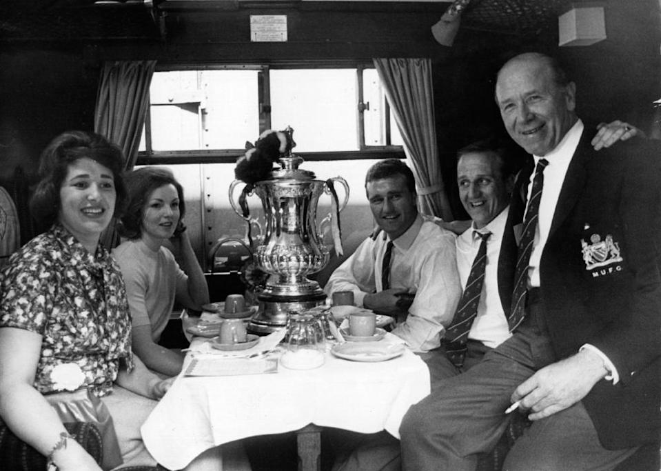 Maurice Setters (second right) with Sir Matt Busby on the train back to Manchester after winning the 1963 FA Cup.
