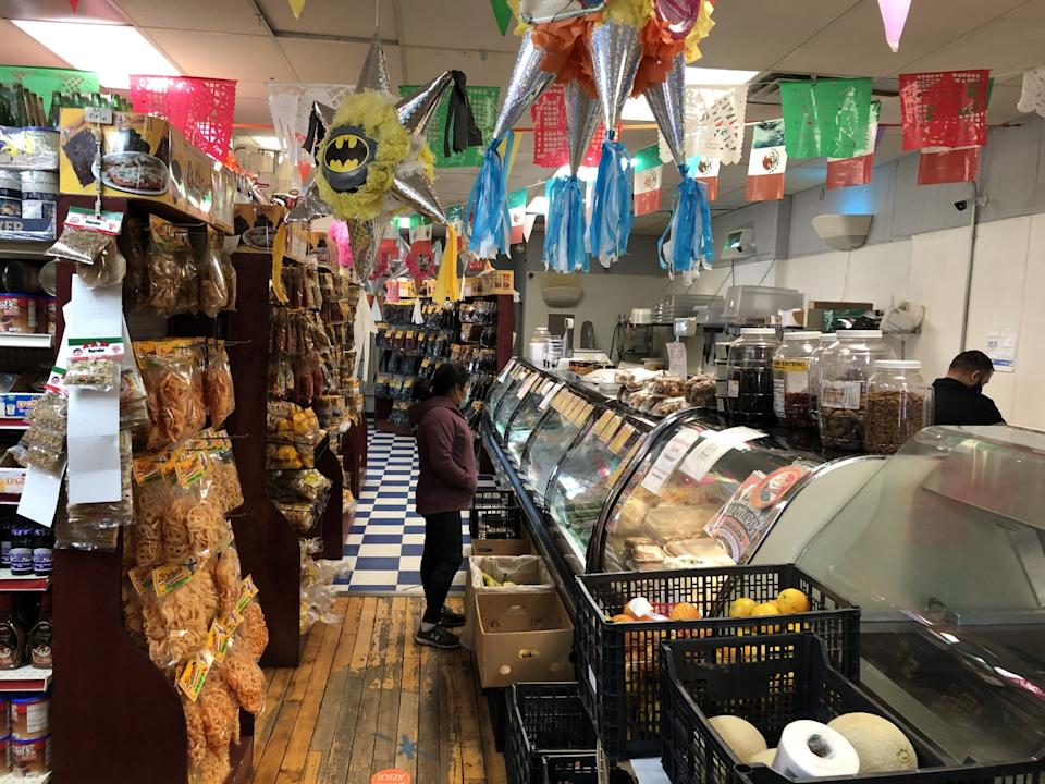 People shop at M.M. San Juan's Mexican Grocery Store in Arcadia, Wis.