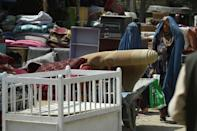 Afghan women have effectively been barred from work and school (AFP/WAKIL KOHSAR)