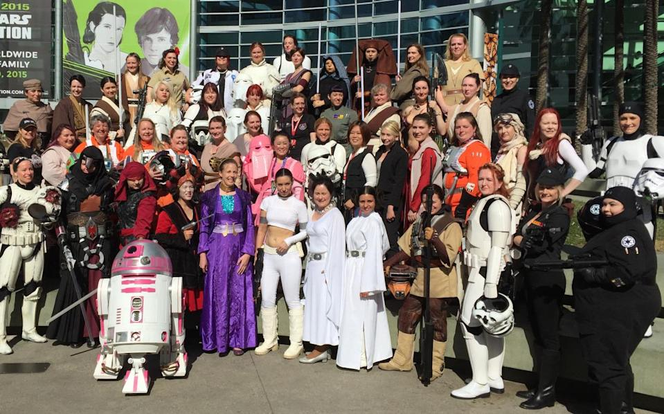 From TIE pilots, to Jedis, to a whole lotta Leias, the ladies of the Celebration take a group shot with the adorable pink astromech R2-KT.
