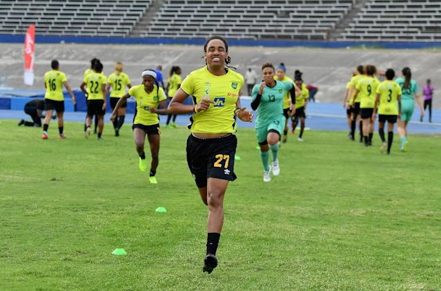 By qualifying for the World Cup, the Reggae Girlz have duplicated the feat achieved in 1998 by the Reggae Boyz, who went to the men's World Cup that year -- also in France (AFP Photo/Angela Weiss)