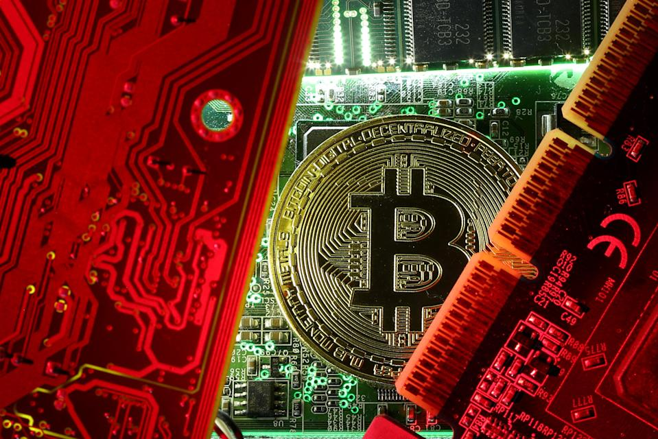 A copy of bitcoin standing on PC motherboard is seen in this illustration picture, October 26, 2017. REUTERS/Dado Ruvic/File Photo