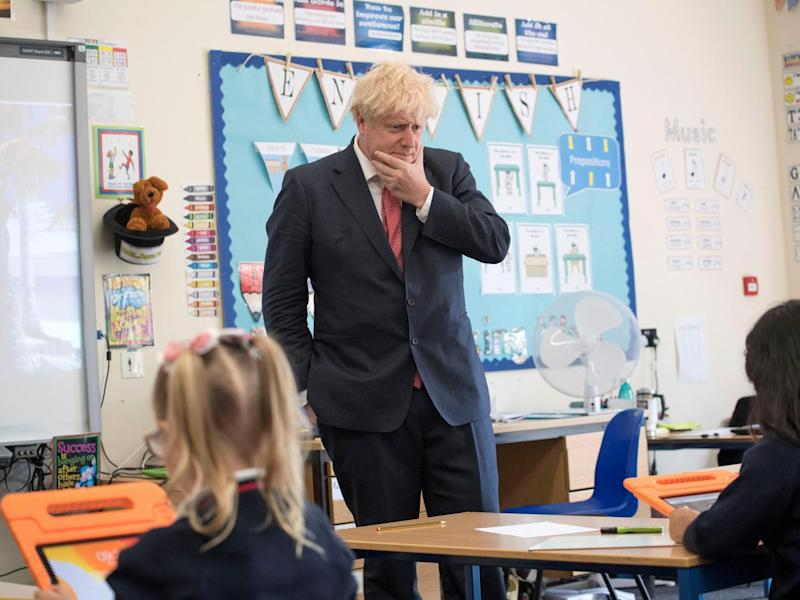 Boris Johnson reacts during a visit to The Discovery School, Kent in July. The PM has urged for schools to fully reopen by September: Reuters
